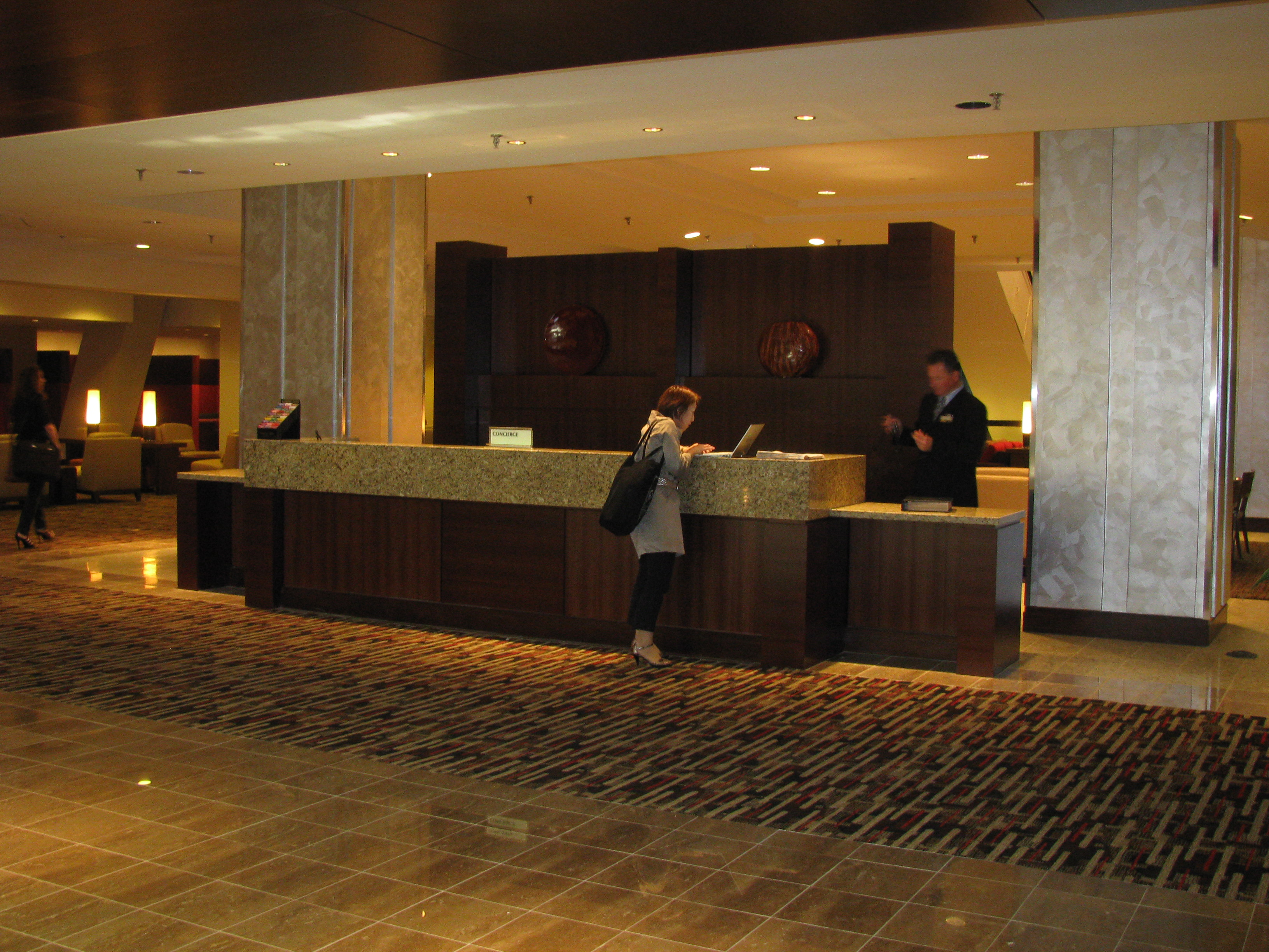 the concierge desk is warm and inviting with the new look - Concierge Desk Design